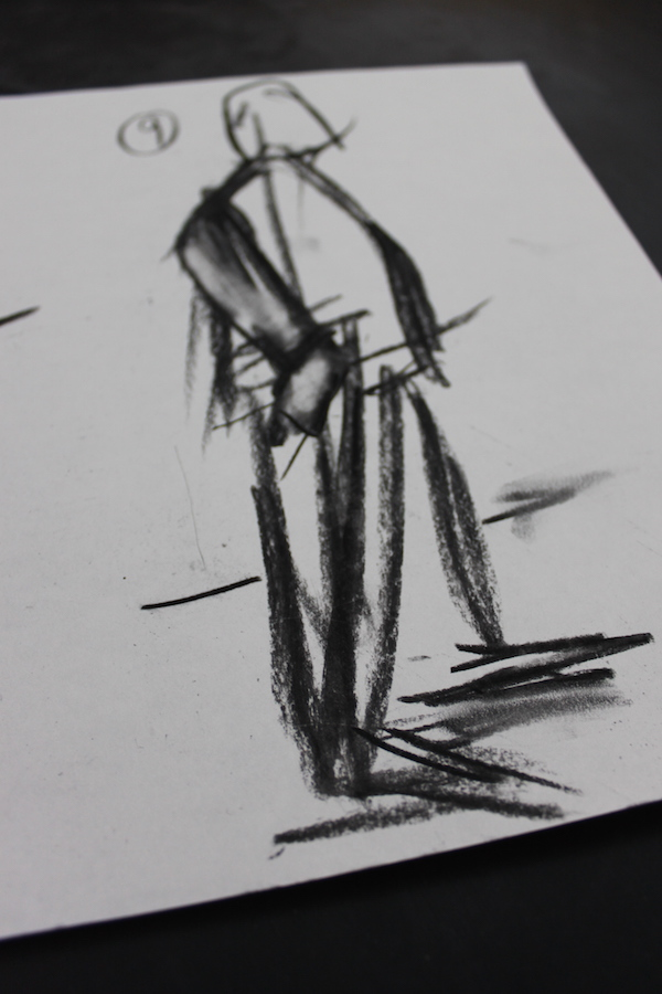 Person in motion with charcoal
