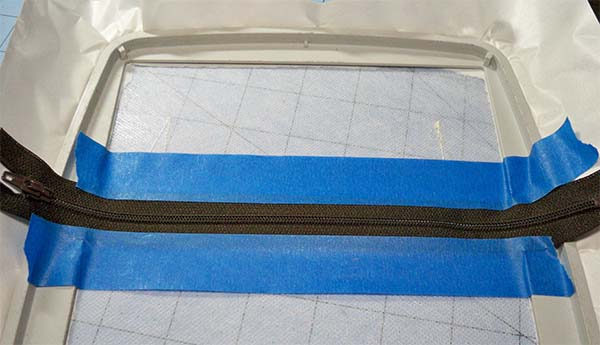 tape ITH zipper in place