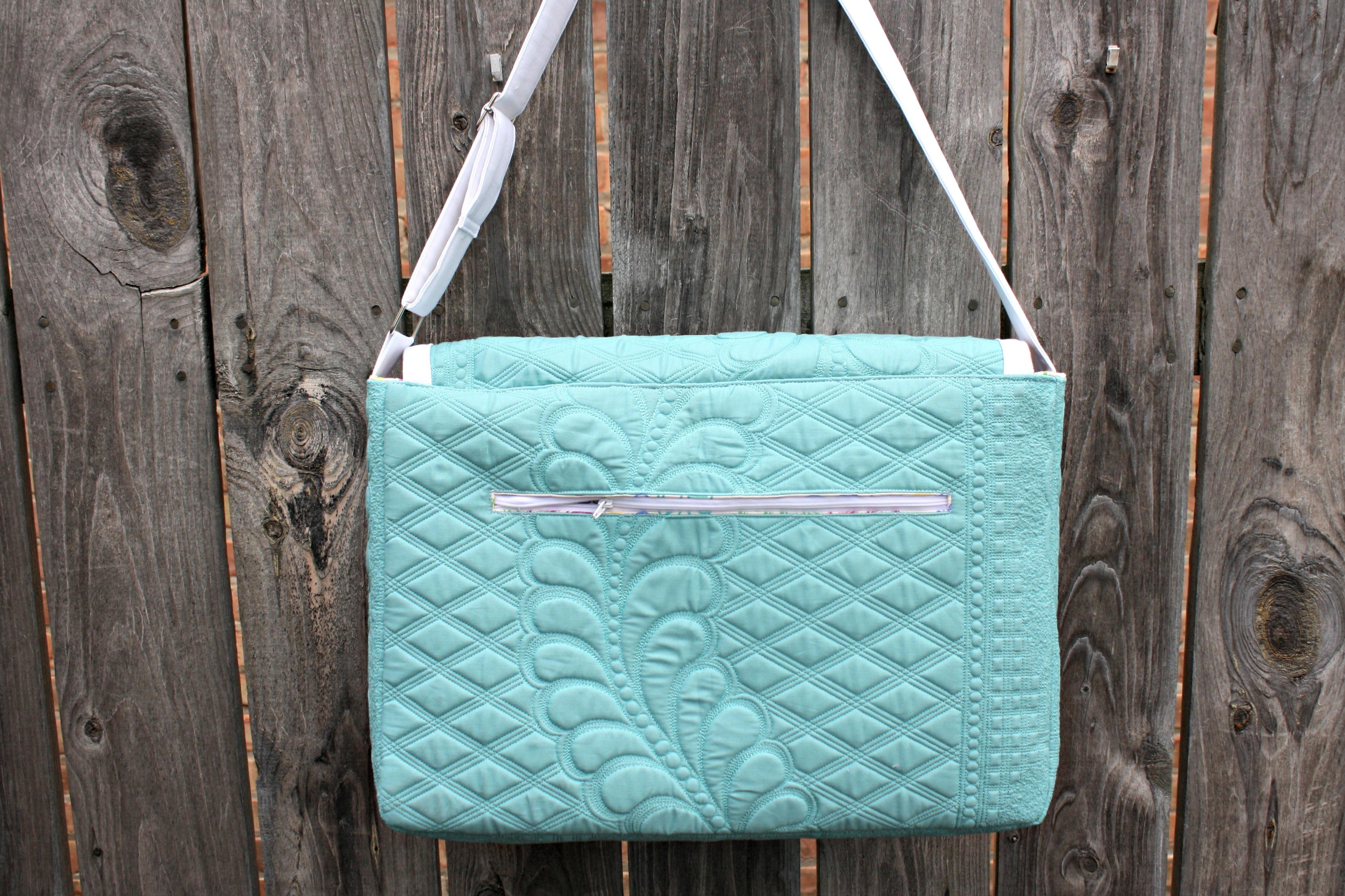Zippered pocket on the back of a bag (Lilium Laptop Bag).