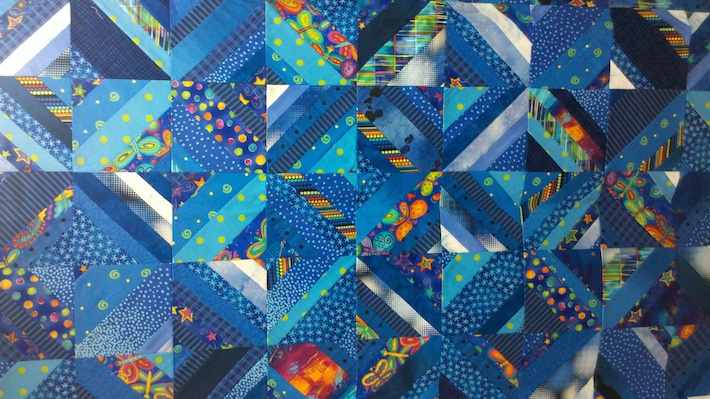 Various blues in a strip quilt by Nancy Smith