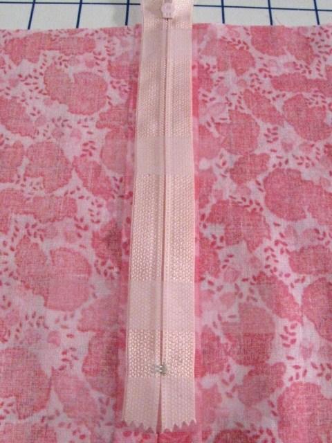 using tape to help sew a zipper