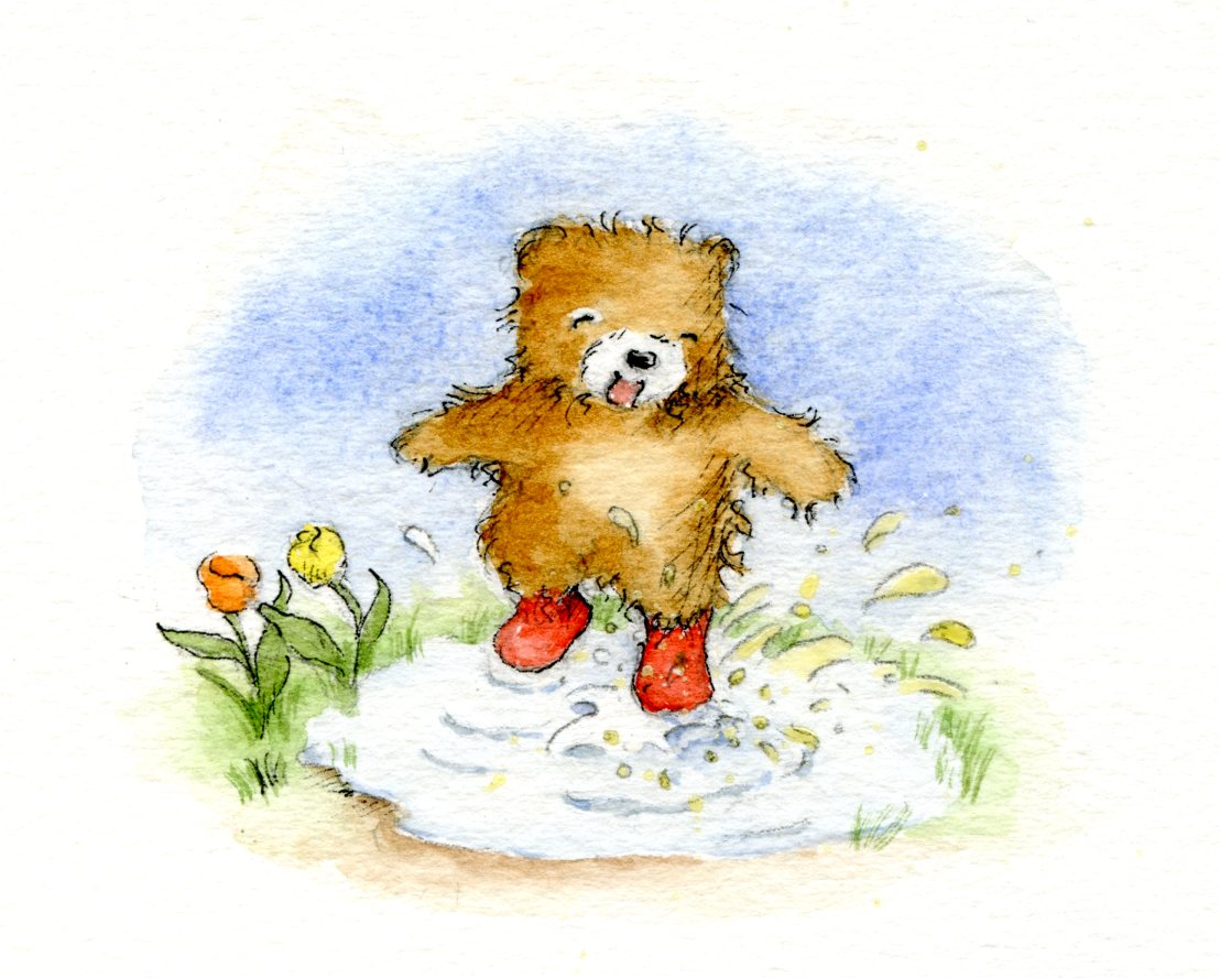 Teddy bear having fun in a puddle