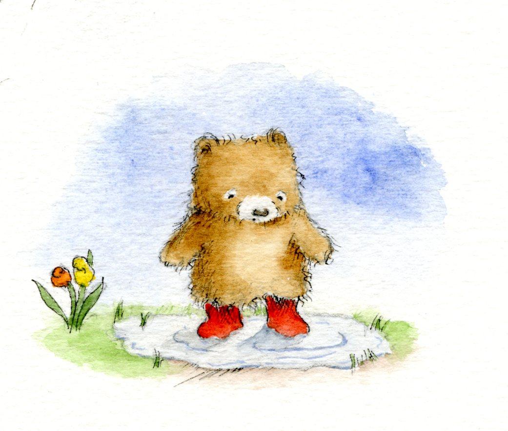 Teddy bear in a rain puddle