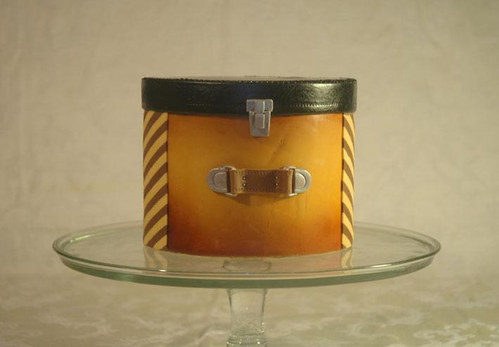 Aged leather hat box cake by Bluprint member Leyda Vakarelov