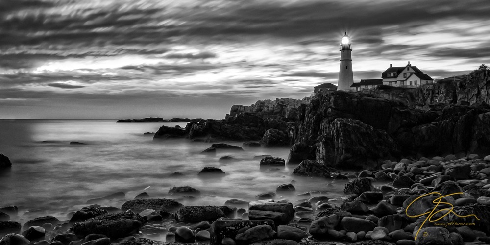 Portland Head Light captured at sunrise. In black and white using a long exposure
