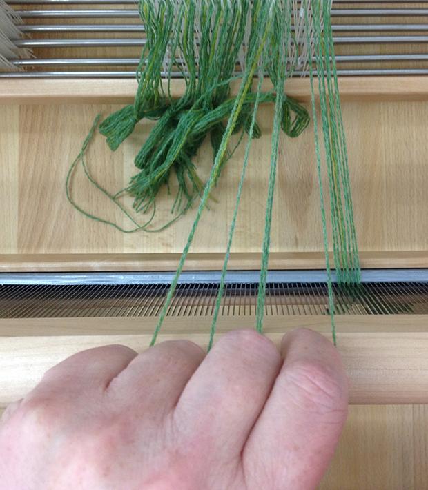 yarn between fingers