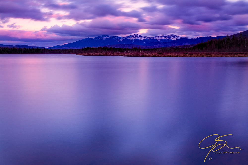 Long exposure photo of Cherry Pond and the Presidential Range of New Hampshire