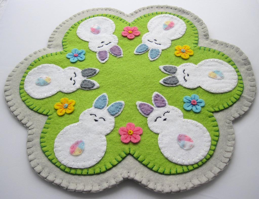 hand embroidered easter themed penny rug made of felt featuring bunnies