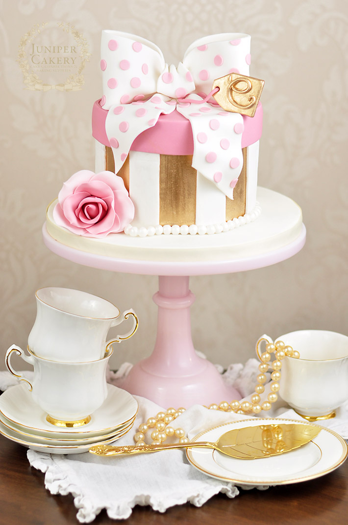 Gold and pink polka dot bow hat bow cake by Juniper Cakery