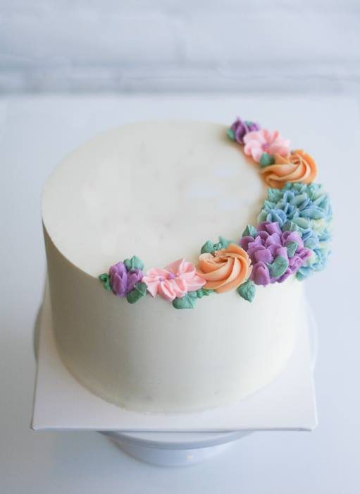 Smooth Buttercream And Piped Flowers by Erica O'Brien | Erin Gardner | Bluprint