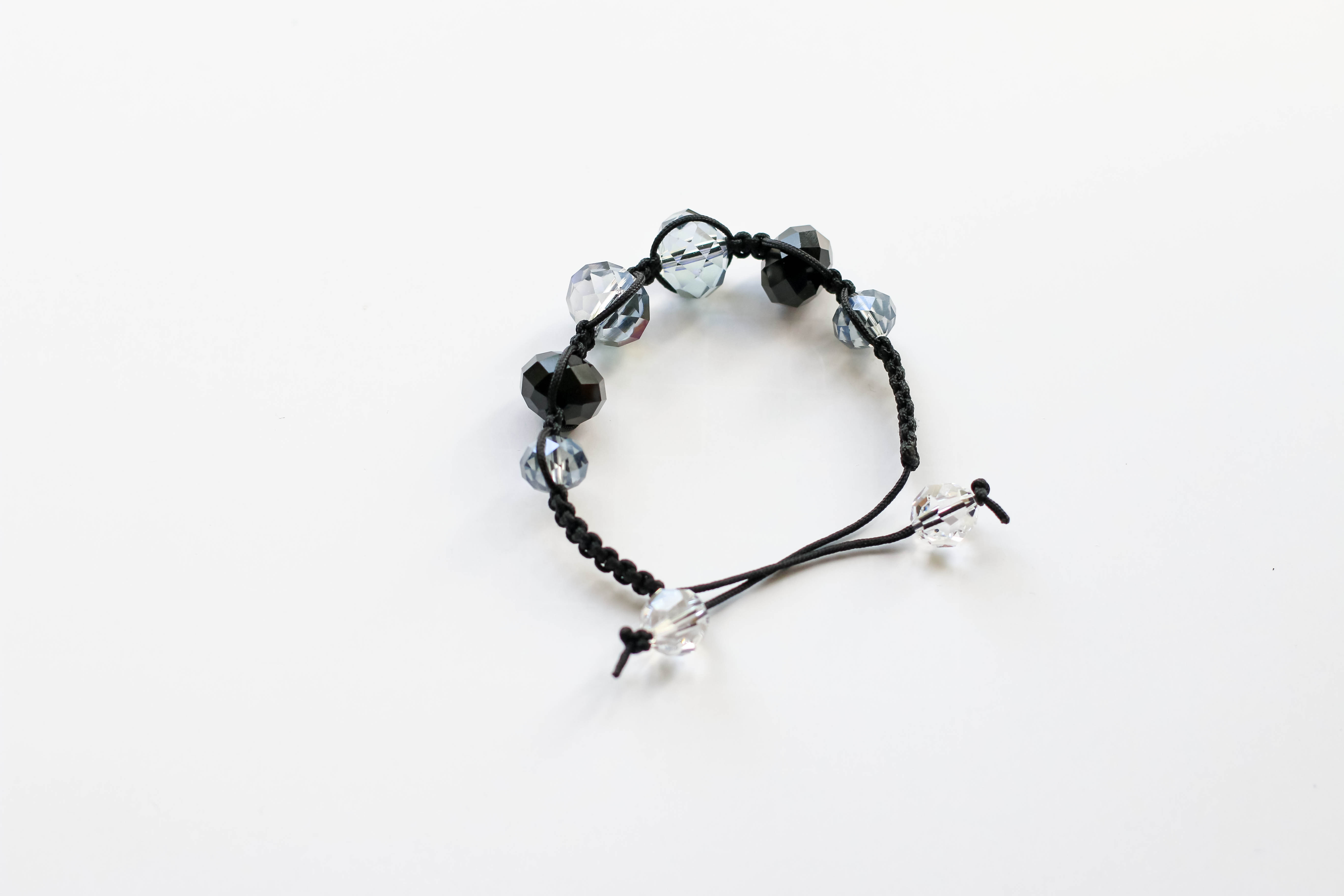 Shamballa bracelet - Bend the work around, overlapping.