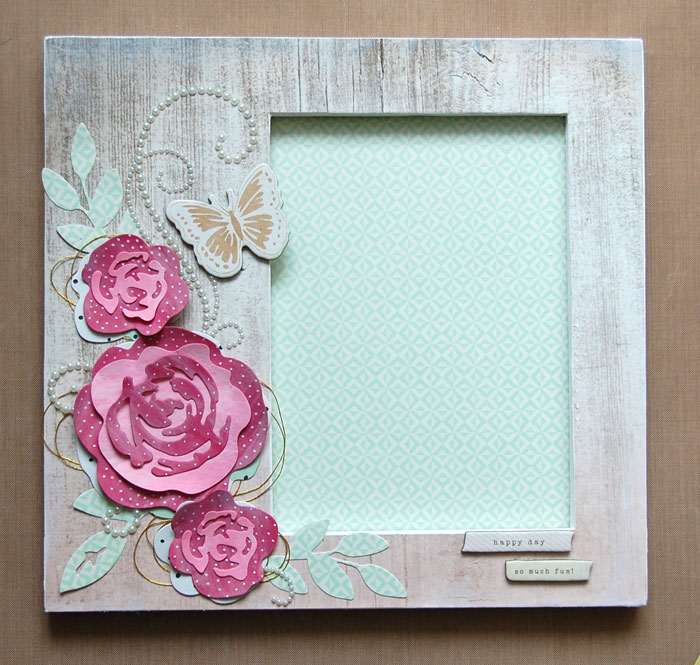 Adhere flowers/embellishments to frame