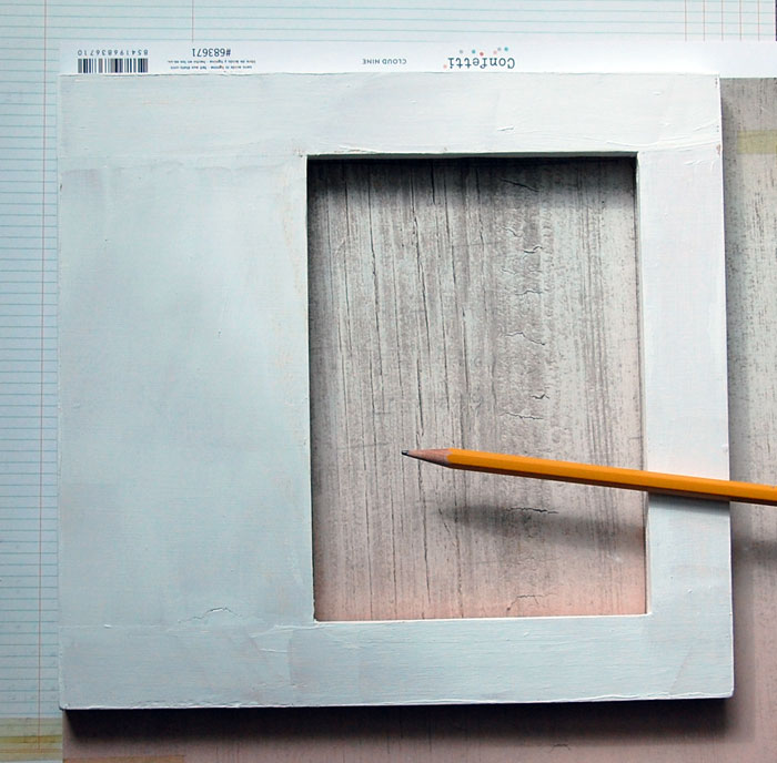 Trace frame onto patterned paper; cut along pencil lines