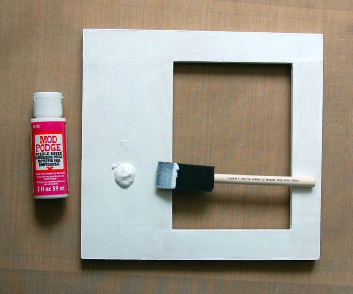 Apply Mod Podge to front of frame and adhere paper