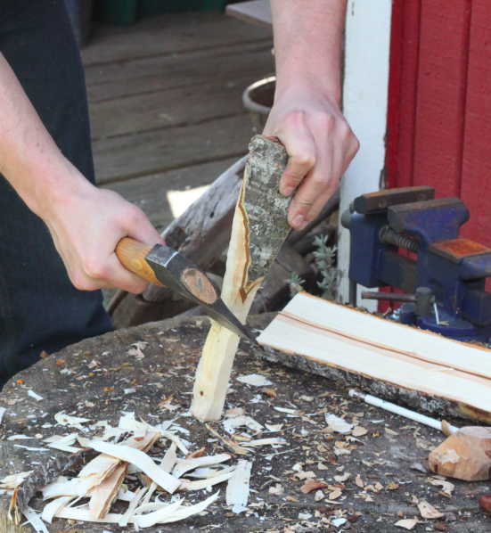 rough shaping the sides of the spoon with a hatchet