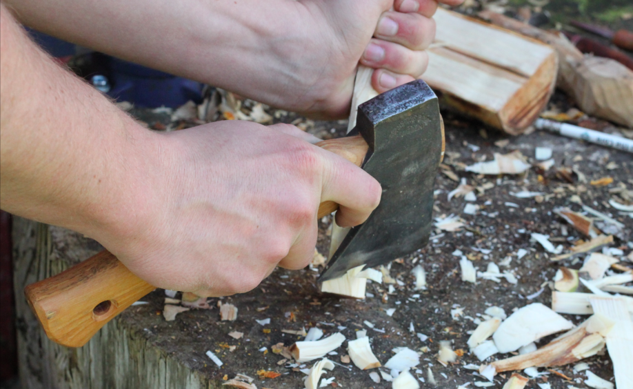 finishing rough shaping the spoon with a hatchet
