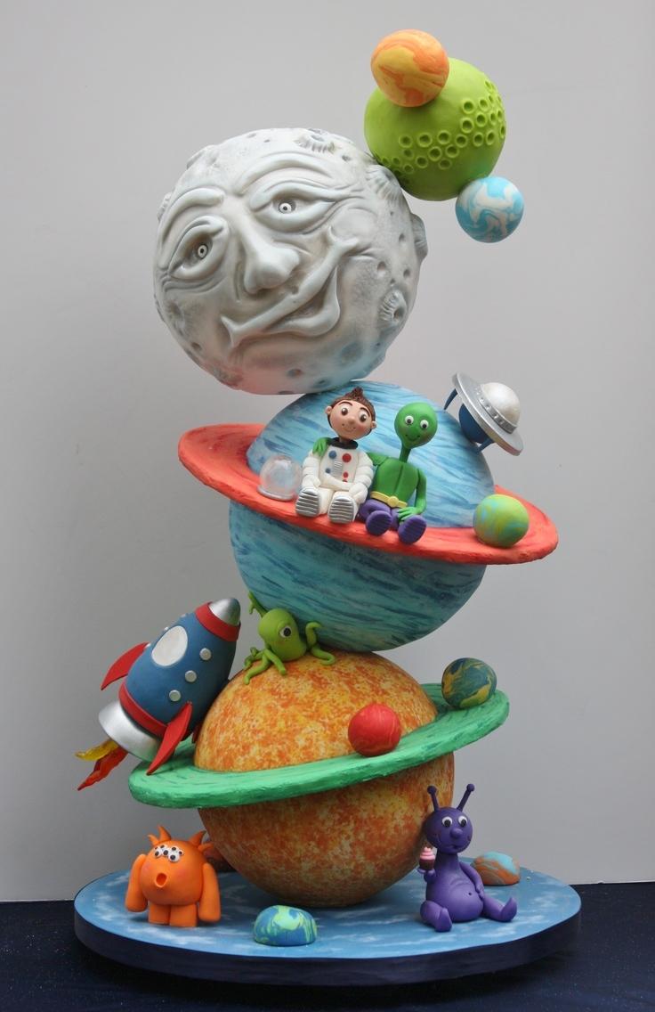 Topsy turvy solar system cake