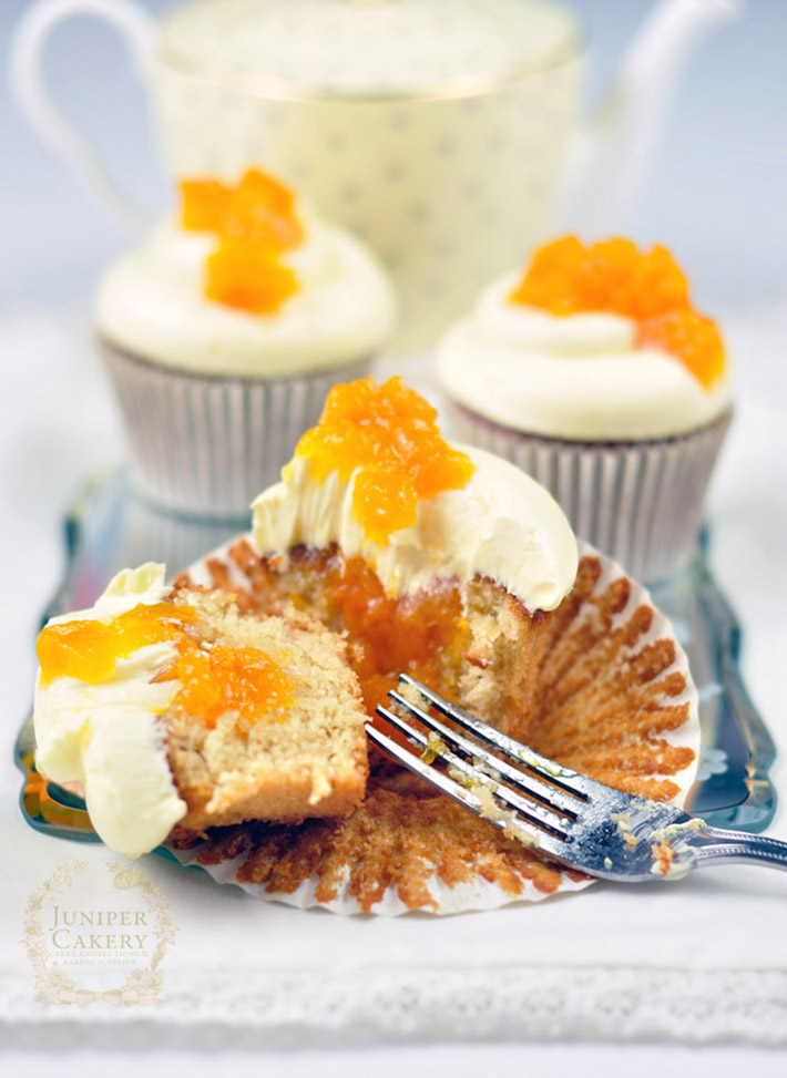 Fill cupcakes with preserves and creams using a piping bag