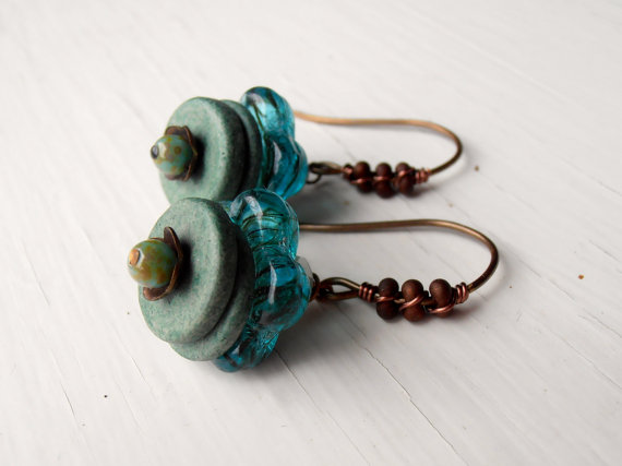 Earrings embellished with peanut seed beads.