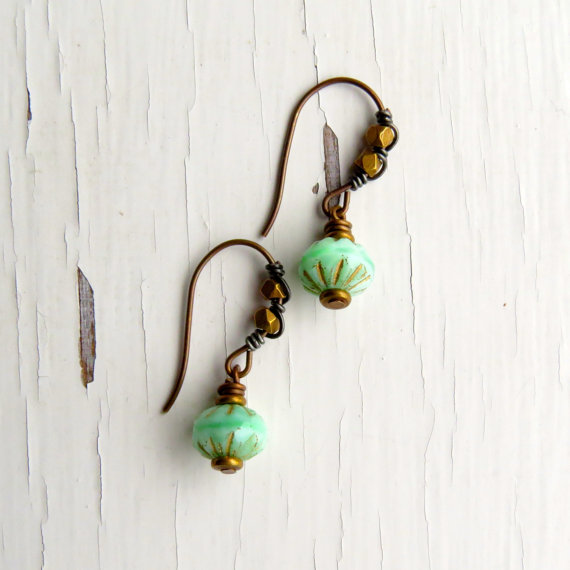 Earrings with earwires embellished with brass beads and contrasting antique silver wire.
