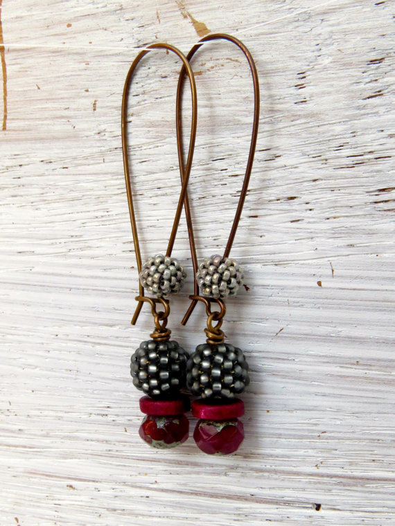 Earrings with earwires embellished with beads coordinating with the main body of the earrings.