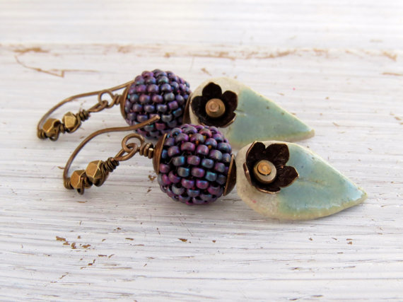 Earrings with earwires embellished with mid-sized brass faceted beads.