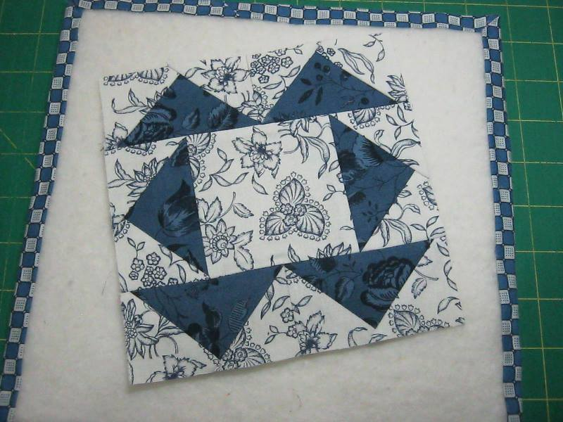 completed quilt block with six flying geese units