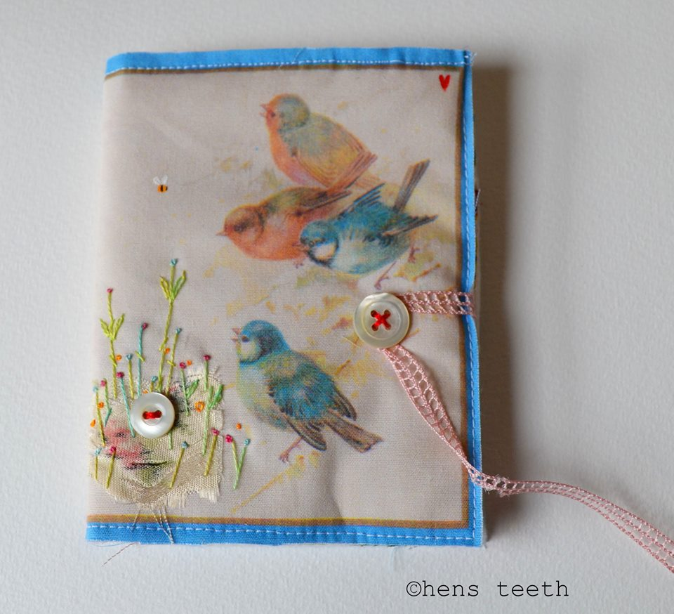 Hens Teeth using printed fabric over stitched and made into a needle case.