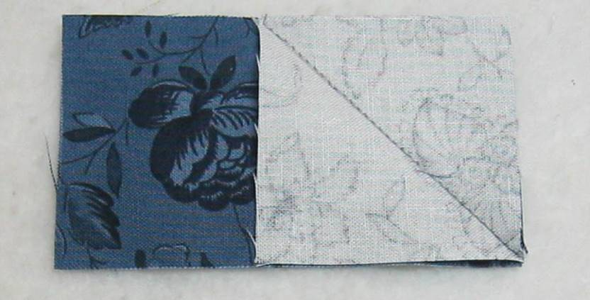 one square sewn on the rectangle fabric on the diagonal line