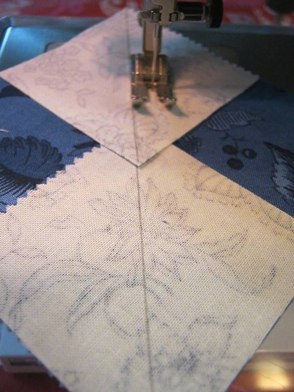 stitching a seam one quarter inch from the drawn on diagonal line with a sewing machine