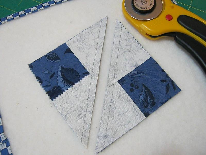 stitched fabric squares cut in half along drawn on diagonal line