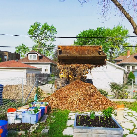 Mulch being delivered to a community garden