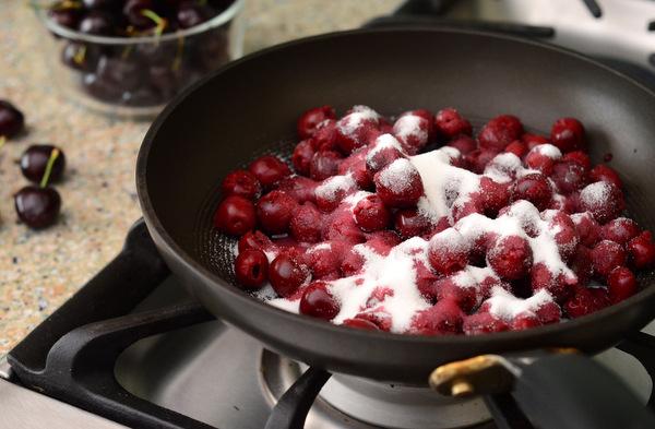 Preparing a wonderful dessert: Cherries Jubilee