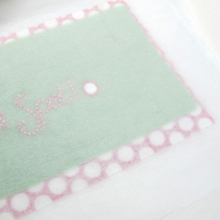 use parchment paper when fusing the front and back fabrics