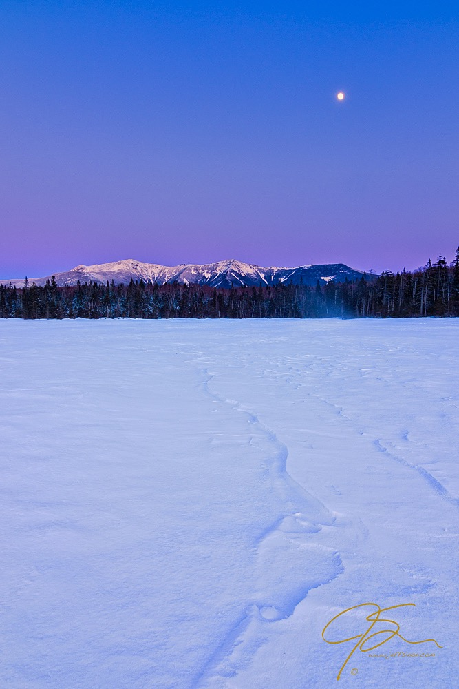moonrise over frozen lake