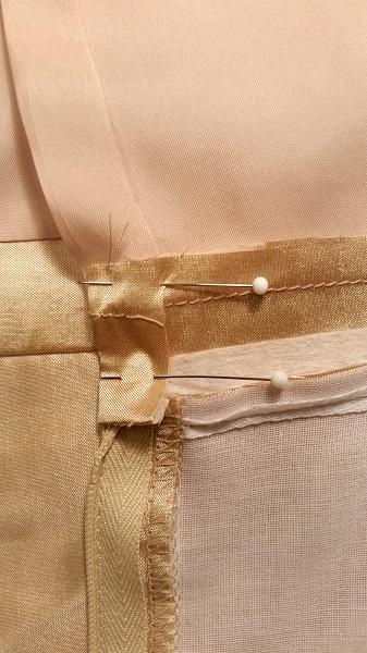 pin end into waistband