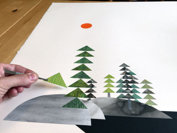 In-progress view of the cut-paper landscape drawing