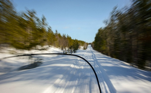high speed photography on snowmobile