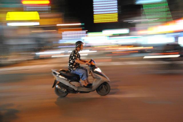 high speed photo of speeding scooter