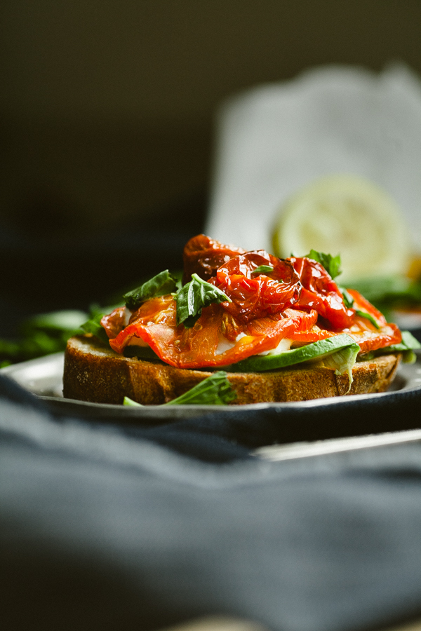 open faced tomato and greens sandwich
