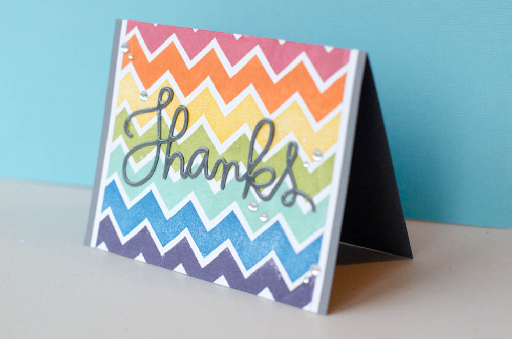 """Thanks"" card with stamped rainbow chevron background"