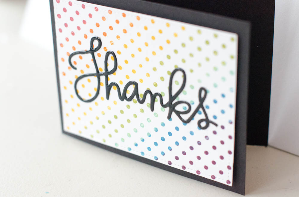 """Thanks"" card with rainbow stamped background"