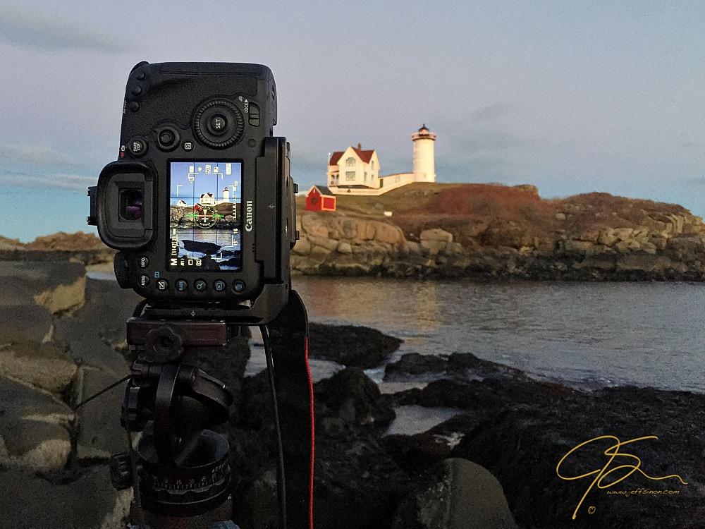 DSLR camera on a tripod using Live View to frame a shot.
