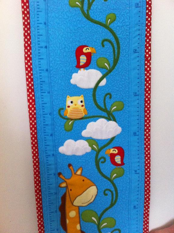 Animals on a quilted growth chart