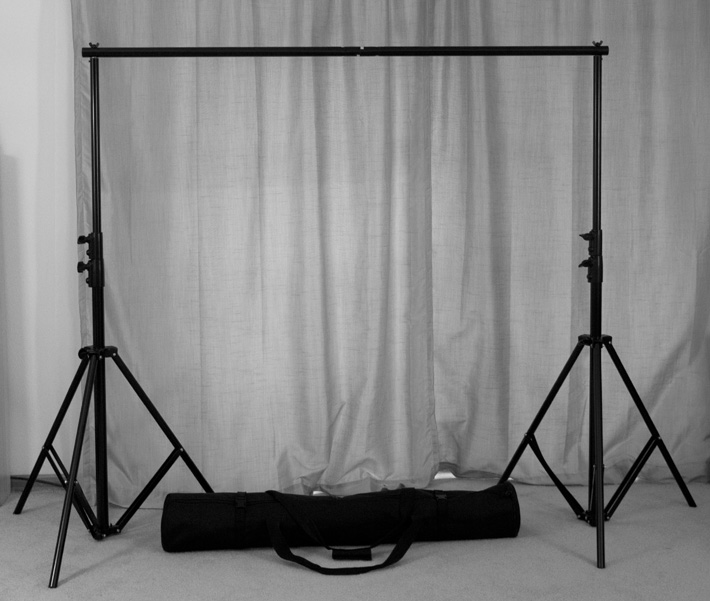 Adjustable backdrop stand with carrying case for newborn and portrait photography