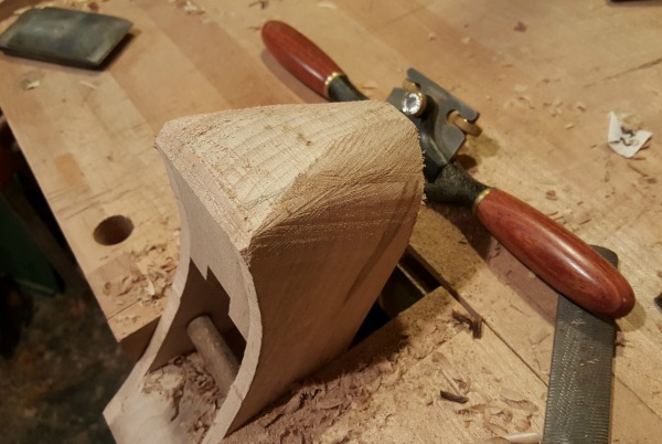 plane being shaped with spokeshave