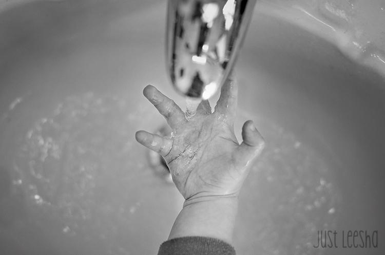 hand under running faucet