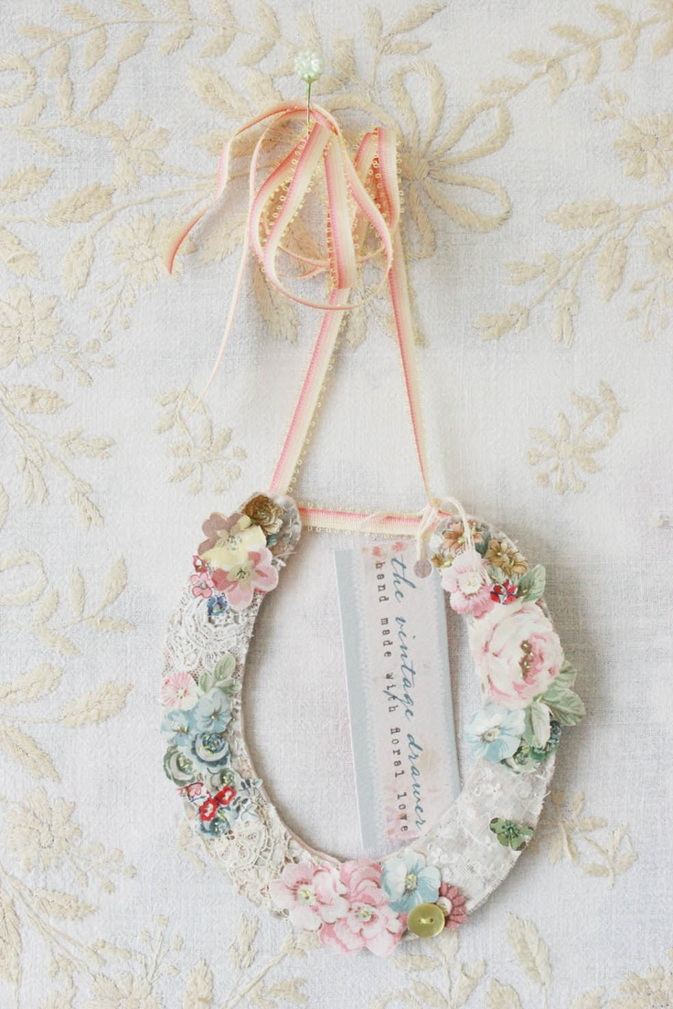 A beautifyl hand stitched floral wedding horse shoe made by Vicky Trainor.