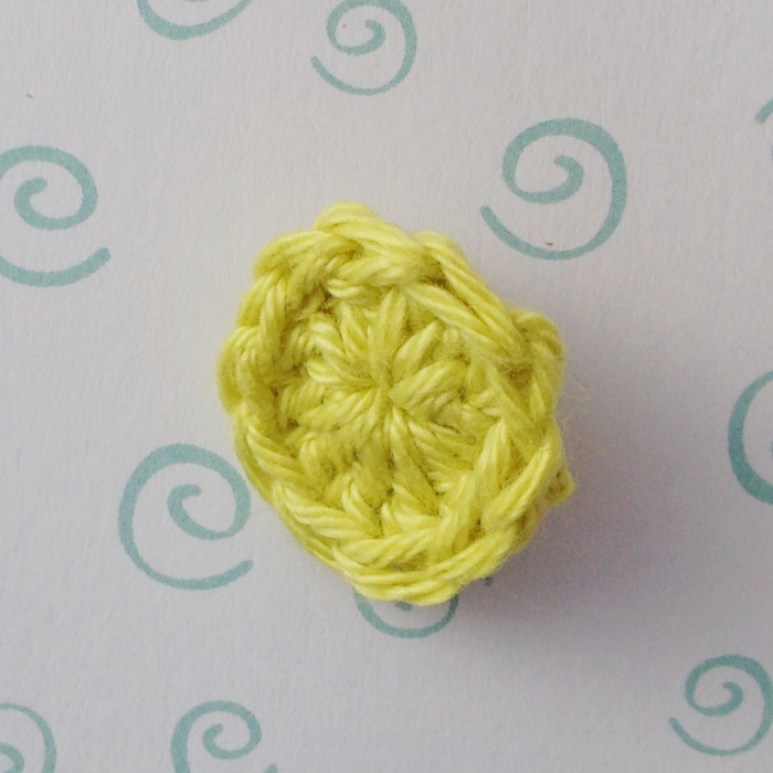 A completed crochet button