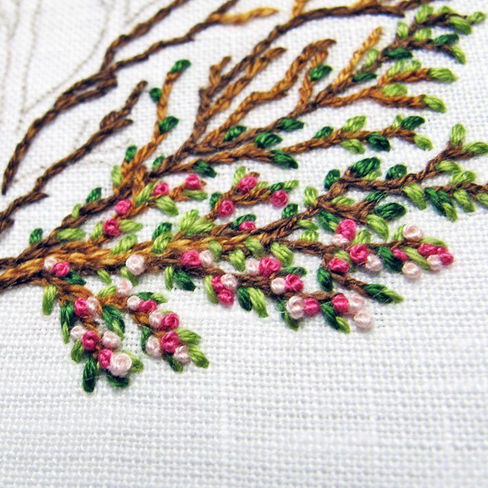 French knot buds on an embroidered tree branch